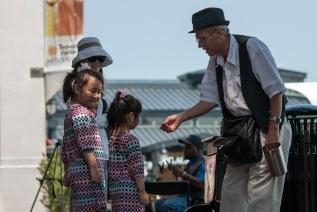 Street Magician, Old Town Waterfront. Nikon D200, 105mm f/2.5 AI, ISO 100, f/4, 1/400 sec